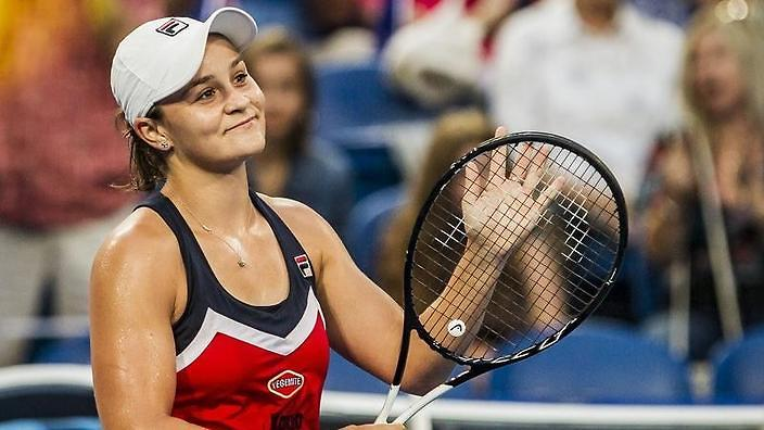 Image result for  Australia's Ashleigh Barty holds the trophy.